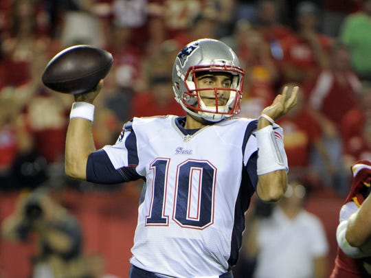 New England Patriots quarterback Jimmy Garoppolo (10) drops back to pass against the Kansas City Chiefs on Monday night.
