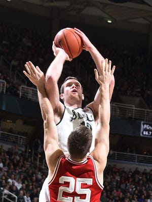 Michigan State's Matt Costello scores against Wisconsin at the Breslin Center on Thursday.