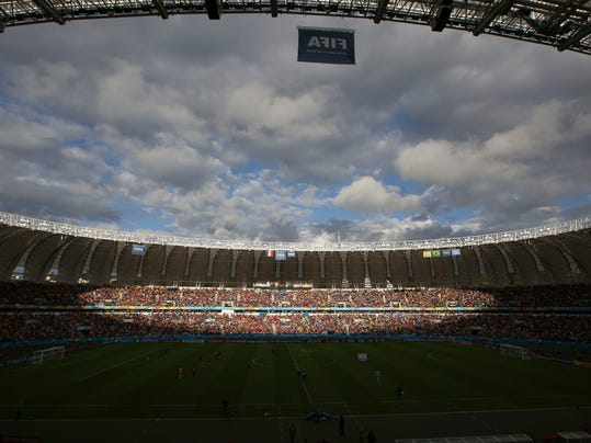Fans wait for the start of the group E World Cup soccer match between France and Honduras at the Estadio Beira-Rio in Porto Alegre, Brazil, Sunday, June 15, 2014.  (AP Photo/Andrew Medichini)