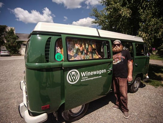 Zach Cutlip, owner of Winewagen Tours, with his 1971 VW bus.