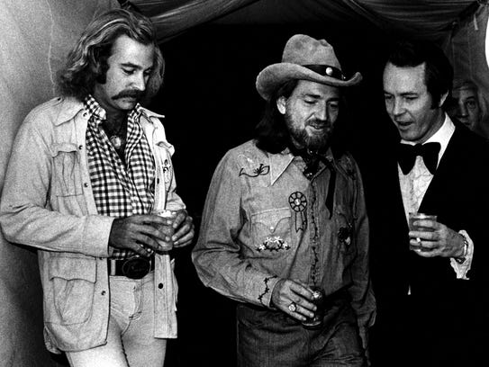 Jimmy Buffett, left, Willie Nelson and Billy Sherrill