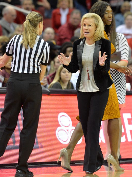 Florida State head coach Sue Semrau, front right, argues a call with referee Karen Preato during the second half of an NCAA college basketball game against Louisville, Sunday, Jan. 21, 2018, in Louisville, Ky. (AP Photo/Timothy D. Easley)