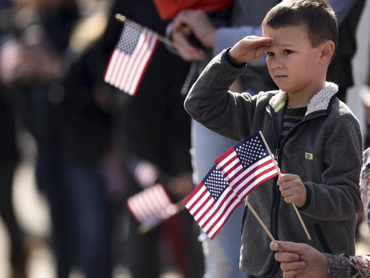 Nick Aiken, 5, salutes during the Southeast North Carolina Veterans Day Parade in downtown Wilmington, N.C., Saturday, Nov. 10, 2018. (Matt Born/The Star-News via AP)