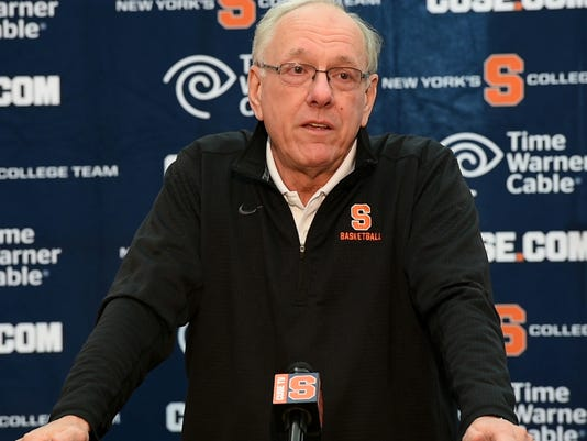 Syracuse coach Jim Boeheim becomes emotional while talking about Pearl Washington during an NCAA college basketball news conference  in Syracuse, N.Y., Wednesday, April 20, 2016. Washington, who went from New York City playground wonder to Big East star for Jim Boeheim at Syracuse,  died Wednesday. He was 52. (Lauren Long/The Syracuse Newspapers via AP) NO SALES; MANDATORY CREDIT