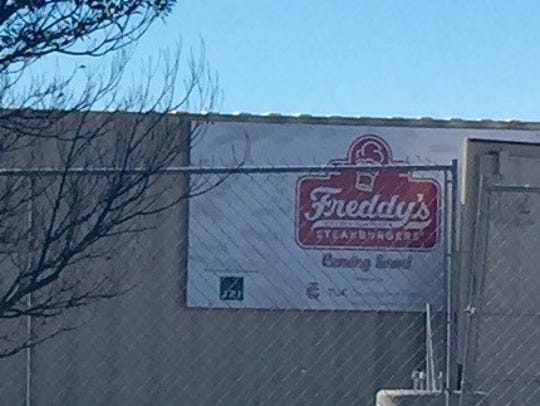 A sign shows the location of Freddy's Steakburgers's.