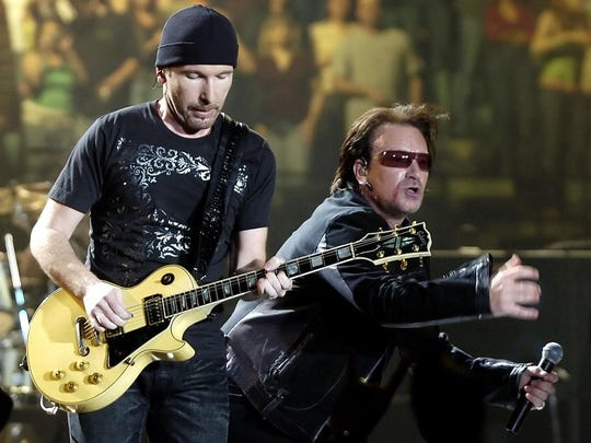 U2 guitarist The Edge, left, and lead singer Bono perform