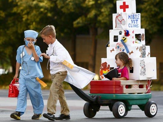 Kristian Olsen-Makdessian, 6, left, and Michael Perkins,