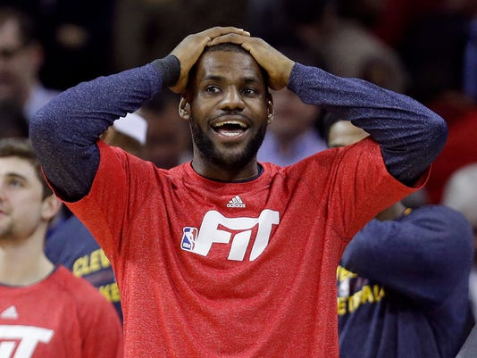 Cleveland Cavaliers' LeBron James watches in the final minute of an NBA basketball game between the Portland Trail Blazers and the Cleveland Cavaliers Wednesday, Jan. 28, 2015, in Cleveland. The Cavaliers defeated the Trail Blazers 99-94. (AP Photo/Tony Dejak)