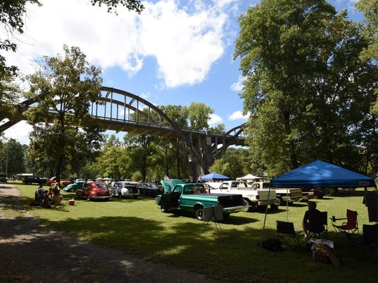 The R.M. Ruthven Bridge towers over the vehicles assembled