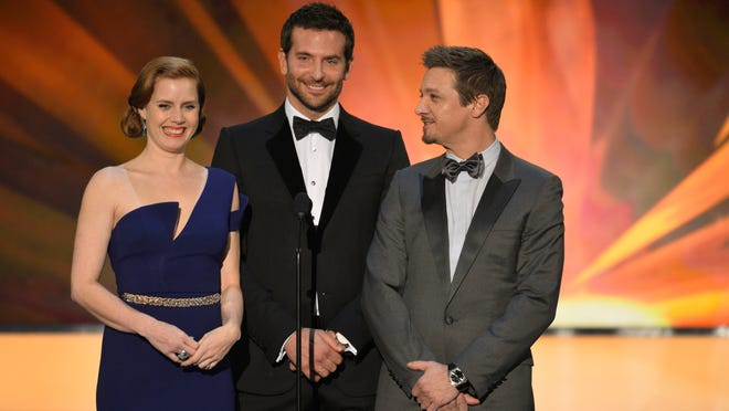 """Amy Adams, Bradley Cooper and Jeremy Renner introduce the clip for """"American Hustle."""""""