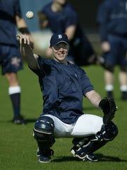 Detroit Tigers catcher Brandon Inge warms in Lakeland, Fla., on Feb. 11, 2003.