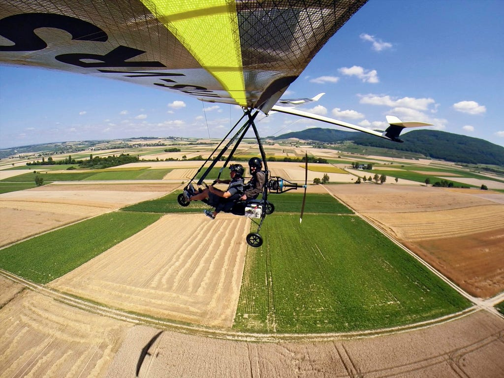 Toni Roth flies with his microlight aircraft over a field at the airfield in Schaffhausen, Switzerland, after a 30-year-ban was lifted.
