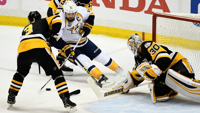 Nashville Predators center Mike Fisher (12) moves in for a shot on Pittsburgh Penguins goalie Matt Murray (30) during the second period of game 1 in the Stanley Cup Final at PPG Paints Arena  Monday, May 29, 2017, in Pittsburgh, Pa.