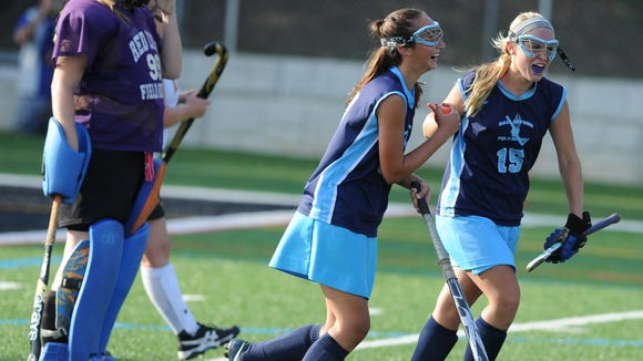 Dallastown's Maggie Noll congratulates teammate Olivia Talley, left after her goal during the Wildcats' 2-0 field hockey victory over the Lions in Red Lion on Monday, Sept. 15, 2014.  Jason Plotkin - Daily Record/Sunday News