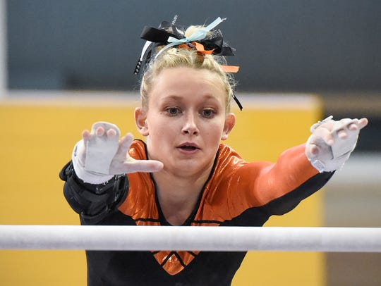 Tech's Taylor Brinkman competes on the uneven parallel
