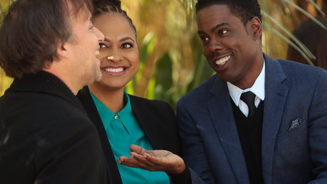 """Chris Rock (right) laughs with Richard Linklater (left) and """"Selma"""" director Ava DuVernay during the Variety Creative Impact Awards brunch on Sunday, January 4, 2015 at the Parker Palm Springs."""