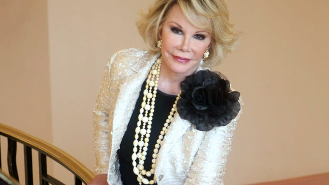 """This Oct. 5, 2009, file photo shows Joan Rivers posing as she presents """"Comedy Roast with Joan Rivers"""" during the 25th MIPCOM (International Film and Programme Market for TV, Video, Cable and Satellite) in Cannes, southeastern France. A federal agency has accepted planned fixes at the New York City clinic where Joan Rivers suffered a fatal complication during a medical procedure."""