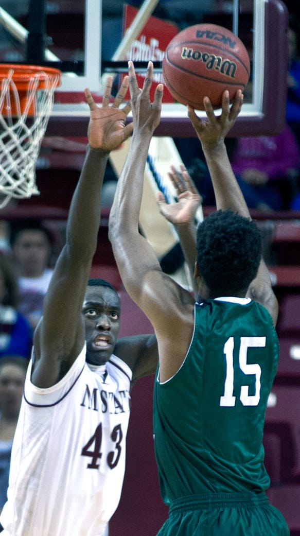 New Mexico State's Pascal Siakam gets his hands in
