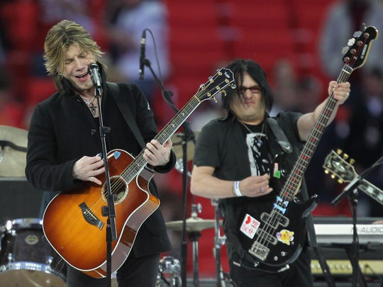 John Rzeznik (left) and Robby Takac of the Goo Goo Dolls perform the pregame entertainment prior to the NFL International Series match between Chicago Bears and Tampa Bay Buccaneers at Wembley Stadium on Oct. 23, 2011 in London