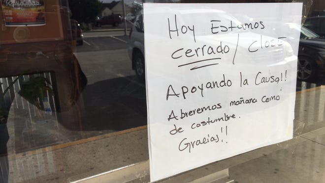 """This sign was posted in a  storefront window Thursday, Feb. 16, announcing that a Hispanic business at the Goliath Shopping Center in Salisbury would be closed for the day in support of """"A Day Without Immigrants."""""""