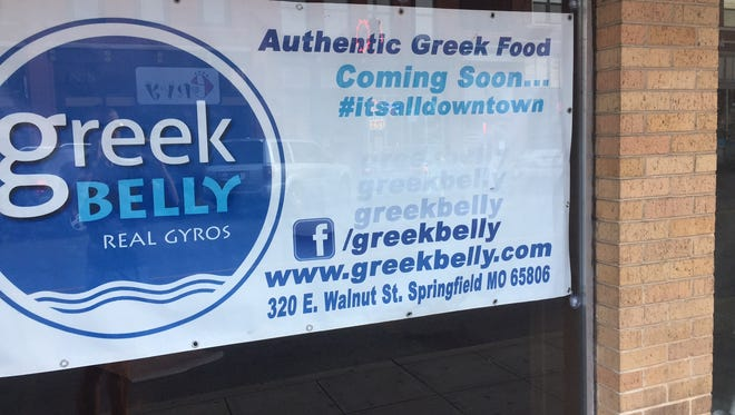 A sign advertising the new restaurant coming to 320 E. Walnut St. in downtown Springfield.