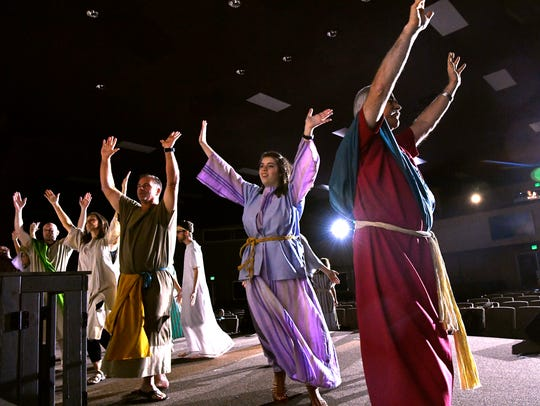 "Actors dance on stage in the sanctuary at Southern Hills Church of Christ during rehearsal for ""Jesus: Life of Love"" on Wednesday."