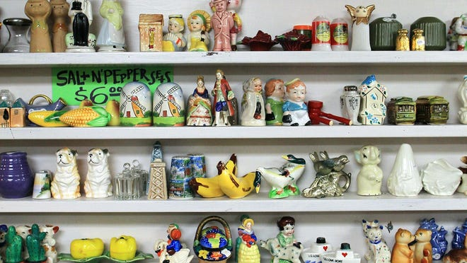 A variety of salt and pepper shakers are seen at Artifacts on Friday, June 19, 2015. David Scrivner / Iowa City Press-Citizen