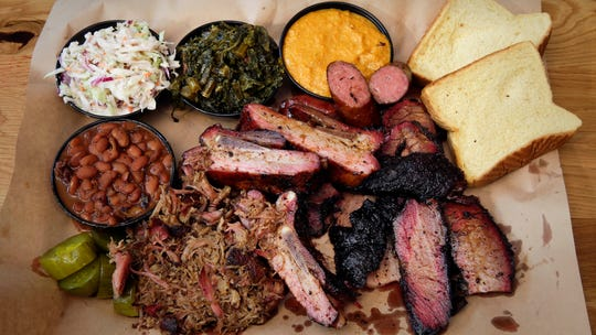 Iron Grate BBQ's platter of brisket, sausage, rib and