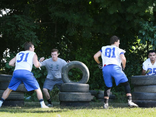 The Caesar Rodney Riders prepare for the start of football season during the first day of football practice Monday.