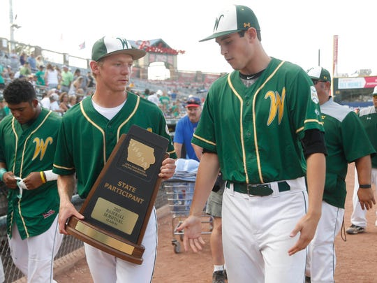 Iowa City West players come off the field following