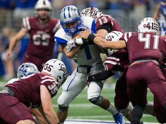 Calallen's defiance brings down McCallum's Alexander Julian during the first quarter of the Class 5A Division II state quarterfinal at the Alamodome in San Antonio on Saturday, Dec. 9, 2017.