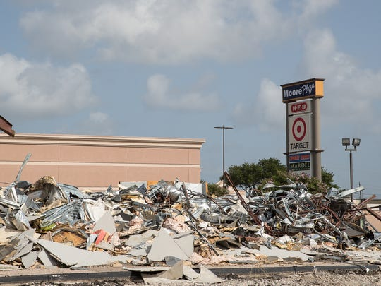 Demolition of the former Taco Cabana in Moore Plaza began over the weekend. City officials say a Raising Cane's chicken restaurant will be built in its place.