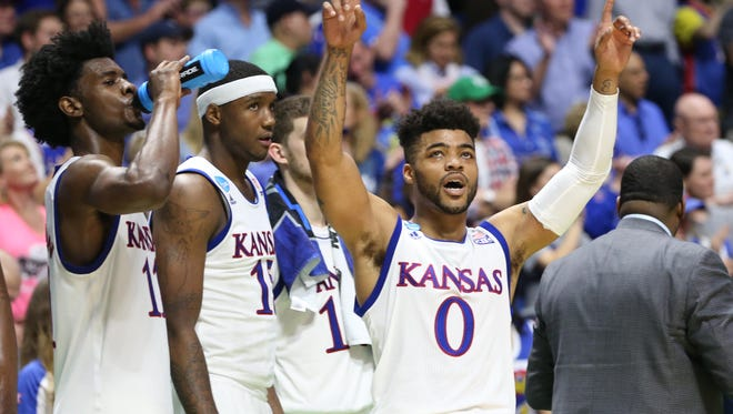 Kansas guard Frank Mason III celebrates on the bench at the end of the team's win against Michigan State.