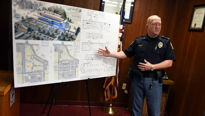 Lt. Jon Traxler shows plans for the Public Safety Complex at a recent press conference. Some residents have expressed concern over the cost of the project.