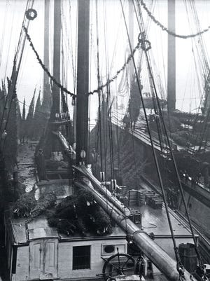 The Rouse Simmons sits in dock with Christmas trees filling its deck in 1908.