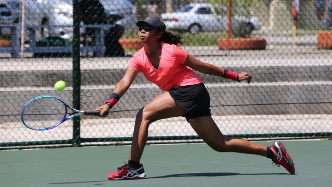 No. 7 Ayana Rengiil of Palau extends for a forehand return against Japan's Mana Kawamura during a Round 2 match of the 2016 Chuck E. Cheese's ITF Junior Championships Girls Singles Main Draw at the Rick Ninete Tennis Center in Hagåtña Wednesday. Kawamura won 6-1, 6-1.