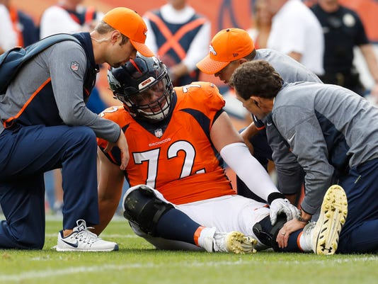 Denver Broncos offensive tackle Garett Bolles (72) is helped after an injury against the Dallas Cowboys during the second half of an NFL football game, Sunday, Sept. 17, 2017, in Denver. Broncos coach Vance Joseph says rookie tackle Garett Bolles' left leg injury isn't as serious as first feared. Joseph says Bolles has a bone bruise in his lower left leg and is week to week. The Broncos' first-round draft pick was injured in Denver's win over Dallas.(AP Photo/Joe Mahoney)