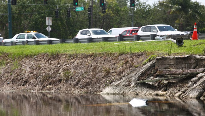 A car flipped into a canal on Immokalee Road and Livingstone Road on Thursday, June 15, 2017.