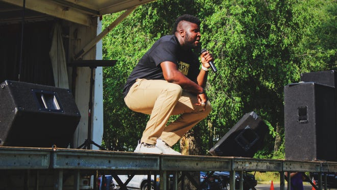 Western Michigan redshirt junior tight end Odell Miller performs with his group 'God's Army' during Battle Creek's Juneteenth and Family Day Celebration at Claude Evans Park on June 17.