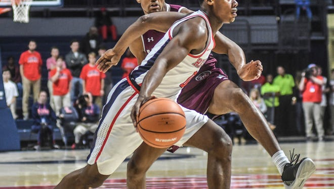 Mississippi's Devontae Shuler (0) is defended by Eastern Kentucky's Zach Charles (12) during an NCAA college basketball game in Oxford, Miss., Monday, Nov. 13, 2017. (Bruce Newman/The Oxford Eagle via AP)