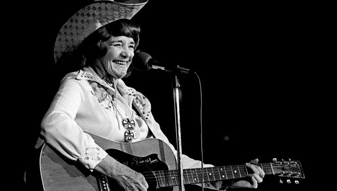 Western music star Patsy Montana of the old National Barn Dance is performing for the crowd during the Country Music Association's fourth annual Family Reunion Show as the Fan Fair winds up its activities at Municipal Auditorium June 14, 1975.