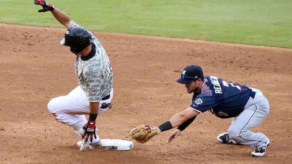 Chihuahuas base runner Rafael Ortega reaches second base before Reno second baseman Jack Reinheimer can reach with the tag Monday night at Southwest University Park.