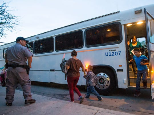 Migrants are released from ICE custody at a Greyhound Bus station in Phoenix May 28, 2014. The Border Patrol says about 400 migrants were flown from Texas to Arizona because of surge in migrants being apprehended in Texas. This group was from Texas.