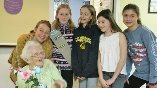 Standing from left, Glen Ridge Troop 21265 Scouts Sarah Johnson, Katie Ross, Natalie Garcia, Naomi Kahl, and Camille Azeglio gather with Van Dyk resident Rose Demoura.