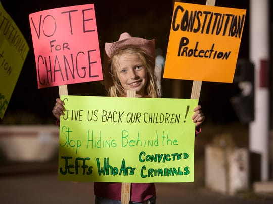 Residents gather in Hildale to protest connections between the FLDS church and area marshals Saturday, Oct. 24, 2015.