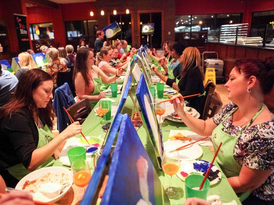 Paint Nite offers a party atmosphere at restaurants for amateur painters, like this class at Bertucci's in Wilmington.