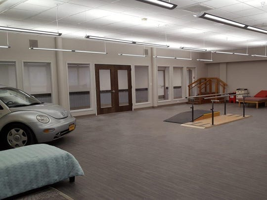 The new rehabilitation room at Creekview Nursing and Rehabilitation Center has a car to help people regain function for activities of daily living.