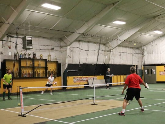 Players participate in a past Taconic Sport and Racquet's