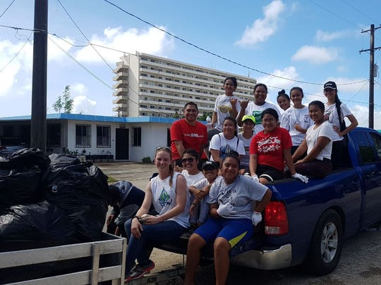 The John F. Kennedy High School Micronesian Youth Club did an environmental trash cleanup on Nov. 18 in the Taitano Road, Harmon area.