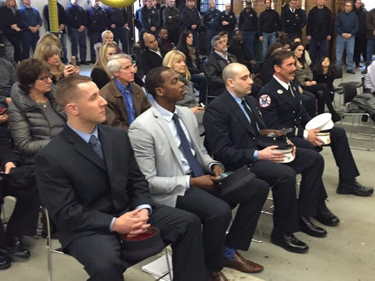 From left, White Plains probationary firefighters William Simons and Hassan Washington, new Lt. Richard Servello and new Deputy Chief Leonard Bonadies at promotion ceremony at White Plains Fire Headquarters, March 20, 2015.